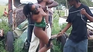 Enchained African babe gets abused by two horny guys - 6:00