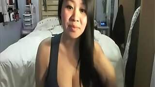 Busty asian teases her white bf on cam - 0:54
